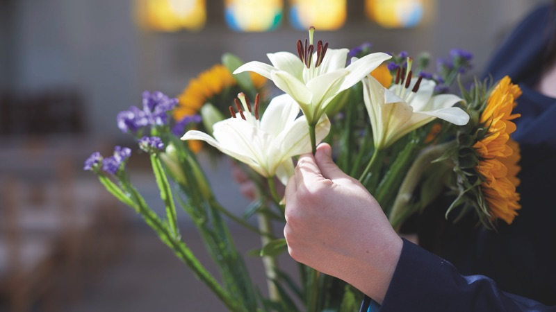 Flowers being arranged at a ceremony